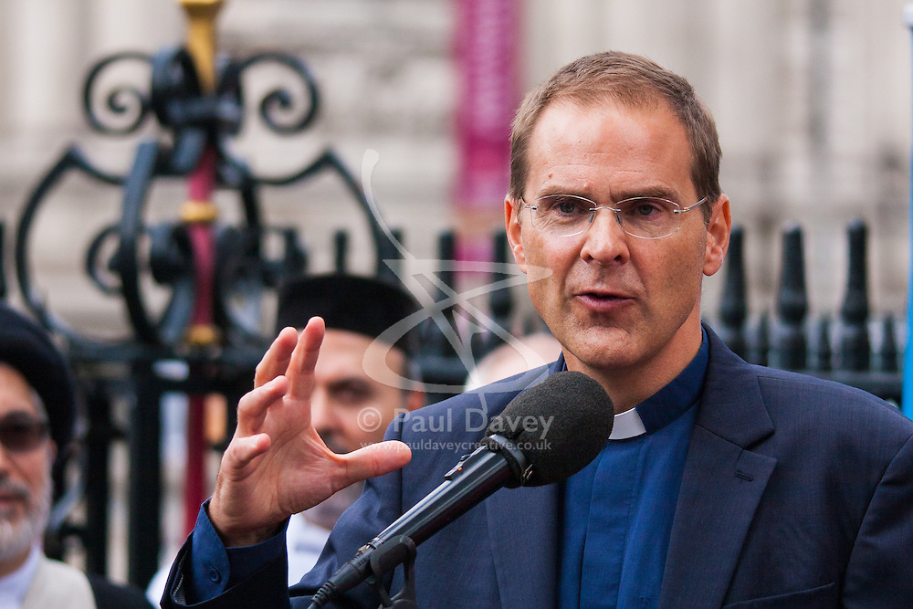 "Westminster Abbey, London. September 3rd 2014.  Leaders of different faiths meet at Westminster Abbey in London to hold a vigil for Iraq organised by World Jewish Relief, Islamic Relief, & Christian Aid, attended by the Most Rev & Rt Hon Justin Welby, Archbishop of Canterbury, Imam Ibrahim Mogra, Ayatollah Dr Sayed Fazel Milani,  Rabbi Laura Janner-Klausner and other senior religious leaders from across the country, where they unfurled a banner stating ""We are all human"". Pictured: The Rev Dr Toby Howarth, Secretary for Inter Religious Affairs for the Church of England. PAYMENT/CONTACT DETAILS: paul@pauldaveycreative.co.uk Te' +44 (0) 7966 016 296 or +44 (0) 208 969 6875"