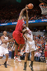 Maryland forward Bambale Osby (50) grabs a rebound from Virginia forward Mike Scott (32).  The Virginia Cavaliers defeated the Maryland Terrapins 91-76 at the University of Virginia's John Paul Jones Arena  in Charlottesville, VA on March 9, 2008.