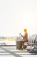 Portrait of businesswoman sititng while waiting for boarding in airport