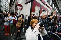 Tourists take photos of the Ankeruhr Clock, designed by the painter and sculptor Franz von Matsch, at Hoher Markt, Vienna, Austria