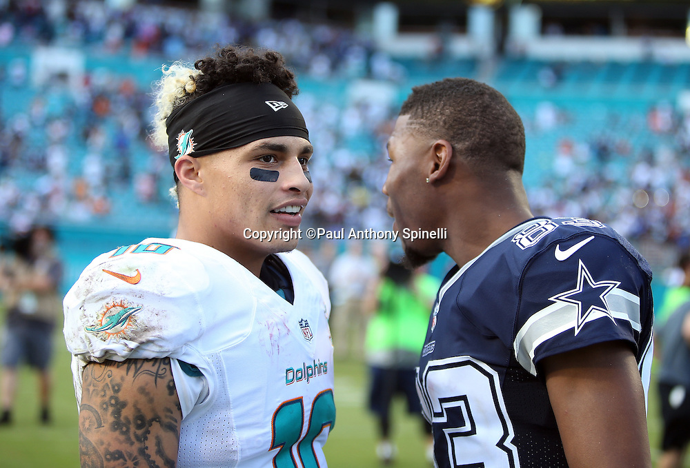 Miami Dolphins wide receiver Kenny Stills (10) talks to Dallas Cowboys wide receiver Terrance Williams (83) after the 2015 week 11 regular season NFL football game against the Dallas Cowboys on Sunday, Nov. 22, 2015 in Miami Gardens, Fla. The Cowboys won the game 24-14. (©Paul Anthony Spinelli)
