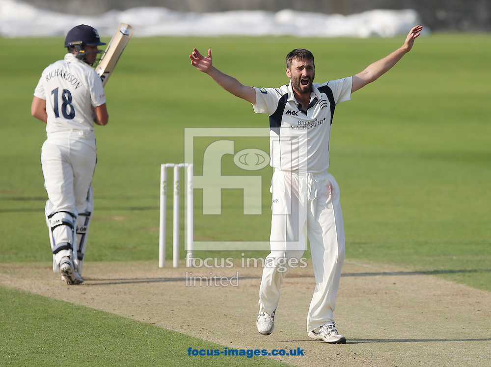 Tim Murtagh (r) of Middlesex appeals for and gets the wicket of Michael Richardson (l) of Durham during the LV County Championship Div One match at Emirates Durham ICG, Chester-le-Street<br /> Picture by Simon Moore/Focus Images Ltd 07807 671782<br /> 23/08/2015