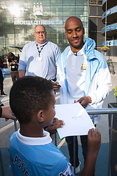 © Licensed to London News Pictures . 17/07/2015 . Manchester , UK . FABIAN DELPH poses for pictures with fans and signs autographs at the Etihad Stadium after signing for Manchester City Football Club , from Aston Villa . Photo credit : Joel Goodman/LNP