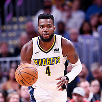 01 April 2018: Denver Nuggets forward Paul Millsap (4) brings the ball up court during the Denver Nuggets 128-125 victory over the Milwaukee Bucks, at the Pepsi Center, Denver, Colorado, USA.