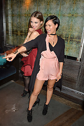Left to right, XENIA TCHOUMI and SINEAD HARNETT at the Fashion Targets Breast Cancer 20th Anniversary Party held at 100 Wardour Street, Soho, London on 12th April 2016.