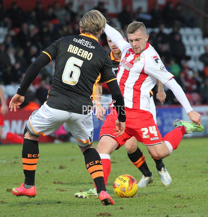 Ryan Brunt fires a shot at goal during the Sky Bet League 2 match between Stevenage and Exeter City at the Lamex Stadium, Stevenage, England on 20 December 2014. Photo by Kieran Clarke.
