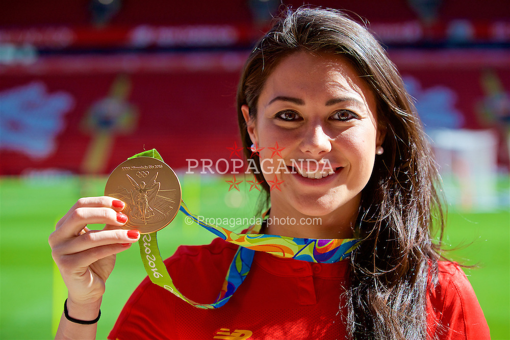 LIVERPOOL, ENGLAND - Monday, August 29, 2016: Liverpool supporter Sam Quek, shows off her Rio Olympics Gold Medal won with the Team GB hockey team, at Liverpool's new Main Stand test event as supporters experience the newly rebuilt stand for the second time at Anfield. (Pic by David Rawcliffe/Propaganda)