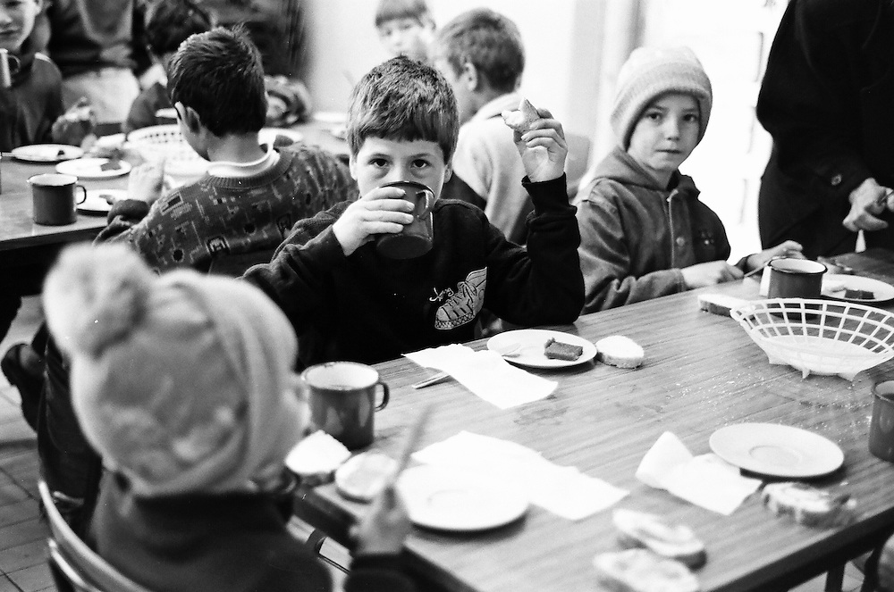 Catalin Cogalniceanu (in the middle) having lunch at the orphanage of Popricani when he was 10 in 1995