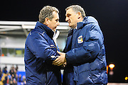 Mickey Mellon and Tony Mowbray shake hands during the Sky Bet League 1 match between Shrewsbury Town and Coventry City at Greenhous Meadow, Shrewsbury, England on 8 March 2016. Photo by Mike Sheridan.