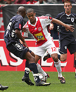 GRANWALD SCOTT looks to get past Sibusiso Vilakazi during the PSL match between Ajax Cape Town and Bidvest Wits held at Newlands Stadium in Cape Town on 13 September2009 ..Photo by Shaun Roy/www.sportzpics.net.+27 21 785 6814..