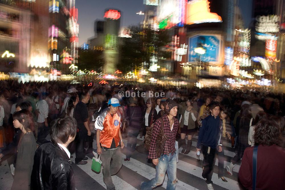 very large crowd walking on the zebra crossing in Shibuya