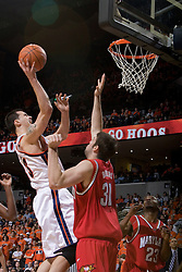 Virginia's Jason Cain (33) lines up a shot over Maryland's Will Bowers (31).  The Cavaliers defeated the #22 ranked Terrapins 103-91 at the John Paul Jones Arena in Charlottesville, VA on January 16, 2007.