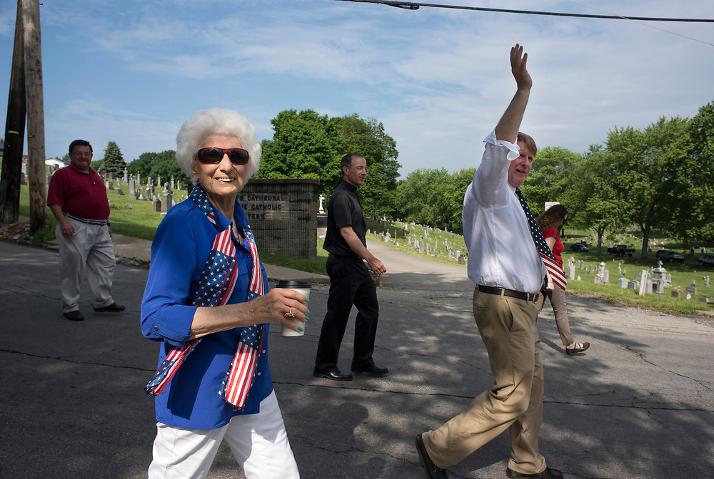 Homestead Mayor Betty Esper walks with Allegheny County Executive Rich Fitzgerald (right) and Father Terry O'Connor (back) in the annual Munhall to Homestead Memorial Day Parade.