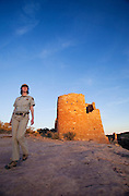 350310-1006 ~ Copyright: George H. H. Huey ~ National Park Service  Ranger Julia Bell at The Castle, Ancestral Pueblo Indian site, Hovenweep National Monument, Utah/Colorado.