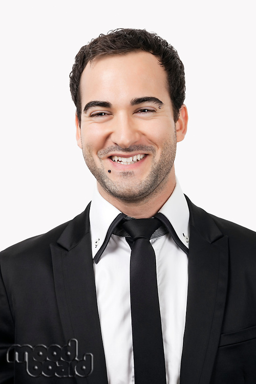 Portrait of cheerful young businessman against white background