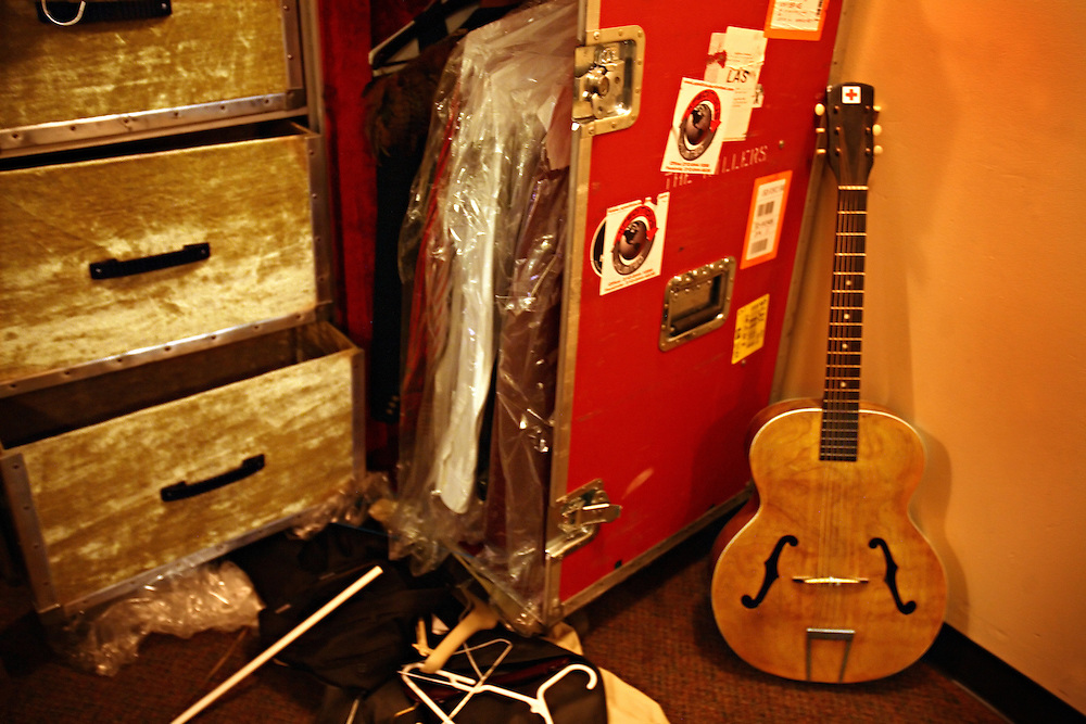 The post-punk band The Killers perform at the Hammerstein Ballroom at Manhattan Center Studios in New York, N.Y. on Oct. 24, 2008. Detail of singer Brandon Flowers clothes and a guitar backstage before their show.