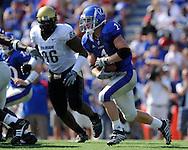 Oct 11, 2008; Lawrence, KS, USA; Kansas Jayhawks running back Jake Sharp (1) rushes up field past Colorado Buffaloes defensive tackle (86) during the third quarter at Memorial Stadium.  Kansas won 30-14.