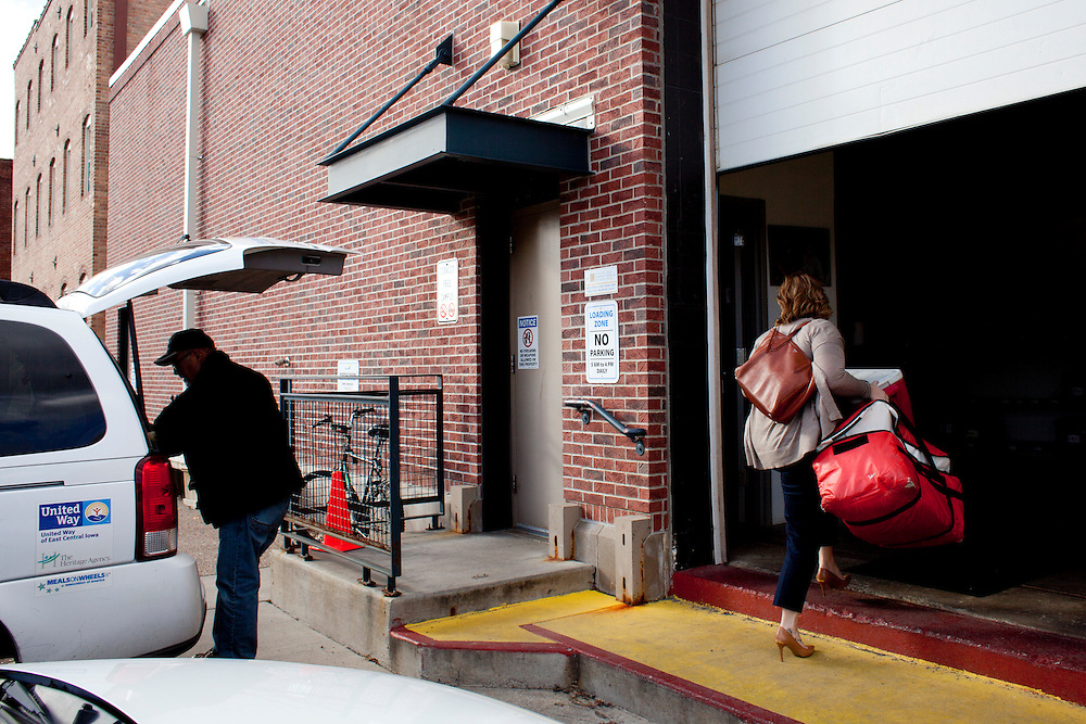 Horizons volunteer coordinator Anna Ronnebaum returns empty Meals on Wheels delivery parcels to the storage area at the organization's facility after finishing her lunchtime route in downtown Cedar Rapids on Thursday, November 19, 2015. Horizons estimates that it serves 800 meals per day, seven days a week in the Cedar Rapids area. (Rebecca F. Miller/Freelance for The Gazette)