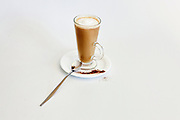 A glass of Instant coffee with milk froth