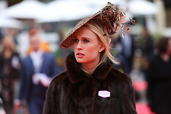 © Licensed to London News Pictures. 08/04/2016. Liverpool, UK. A lady wearing a fur jacket and stunning hat  arrives at the Grand National 2016 for Ladies Day at Aintree Racecourse near Liverpool. The race, which was first run in 1839, is the most valuable jump race in Europe. Photo credit : Ian Hinchliffe/LNP