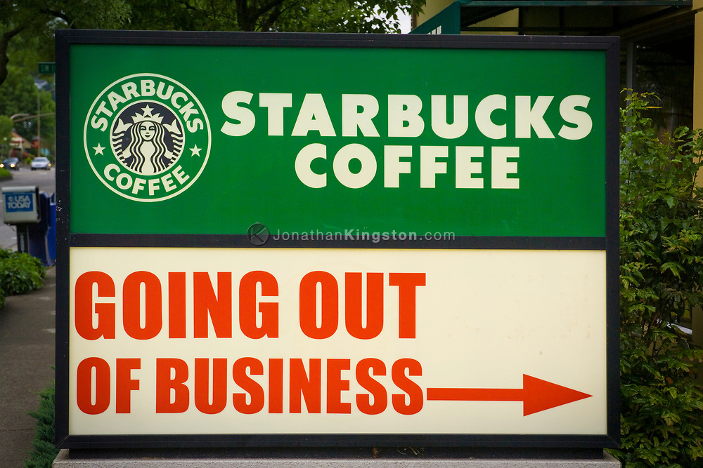 """A Starbucks cafe appears to be going out of business on SW Macadam Ave. in Portland, Oregon.  In fact the cafe is simply located next to a store who?Äôs name is the """"Going Out of Business"""" store."""