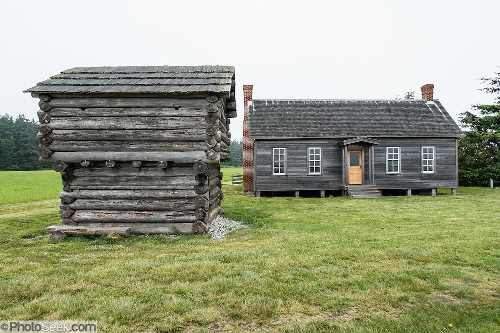 On Ebey's Prairie Trail in Ebey's Landing National Historical Reserve, see the Jacob & Sarah Ebey House, built in 1856. Jacob was the father of Whidbey Island's first permanent Euro-American settler, Isaac Neth Ebey, who arrived in 1850. At left, the Ebey Block House, built in 1854, is one of four remaining today (out of as many as 11 built in the 1850s). The blockhouse was built for defense against Native Americans who were being displaced from their traditional lands. Start your walking tour from Sunnyside Cemetery Wayside on Cemetery Road to explore Ebey's Prairie Trail (or start from the beach lot at Ebey's Landing State Park), on Whidbey Island, Washington state, USA.