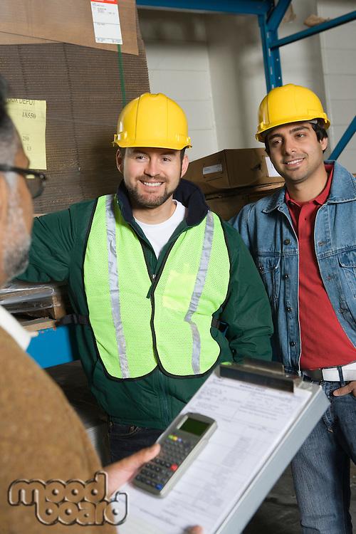 Men wearing hard hats in factory