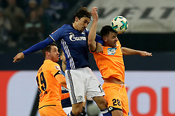 GELSENKIRCHEN, Feb. 18, 2018  Hoffenheim's Adam Szalai (R) and Schalke's Benjamin Stambouli (C) vie for the ball during the German Bundesliga soccer match between FC Schalke 04 and Hoffenheim, in Gelsenkirchen, western Germany, on Feb. 17, 2018. Schalke won 2-1. (Credit Image: © Joachim Bywaletz/Xinhua via ZUMA Wire)
