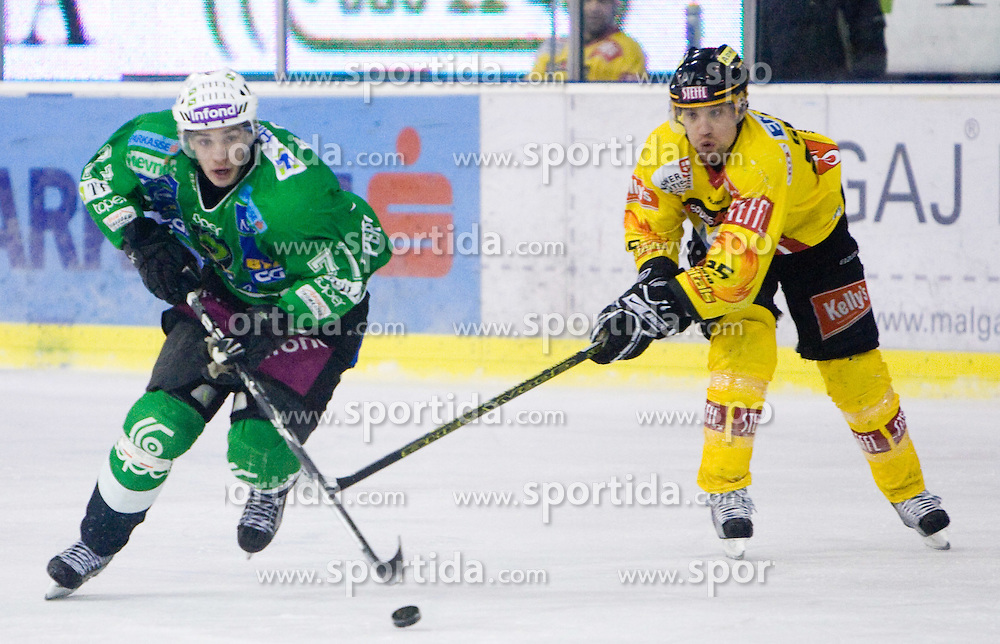 Bostjan Golicic of Olimpija and Benoit Gratton of Vienna during 52nd Round of EBEL league ice-hockey match between HDD Tilia Olimpija, Ljubljana and EV Vienna Capitals, on February 7, 2010 in Arena Tivoli, Ljubljana, Slovenia. Vienna defeated Olimpija 8-2. (Photo by Vid Ponikvar / Sportida)