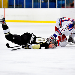 NORTH YORK, ON - Feb 9 : Ontario Junior Hockey League Game Action between North York Rangers Hockey Club and the Trenton Golden Hawks Hockey Club.  Mat Thompson #10 of the Trenton Golden Hawks Hockey Club gets taken down to the ice by Liam Kerins #17 of the North York Rangers Hockey Club.<br /> (Photo by Phillip Sutherland / OJHL Images)