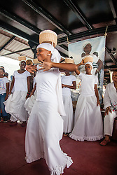 Addaliah Potter dancs the Bamboula while wearing te traditional coal workers basket in remembrance of Queen Coziah and the coal workers who went on strike.  9th Annual Dollar Fo' Dollar Culture and History Tour, a remembrance of the 1892 Coal Workers Strike on St. Thomas.  20 September 2014.  St. Thomas, USVI.  © Aisha-Zakiya Boyd