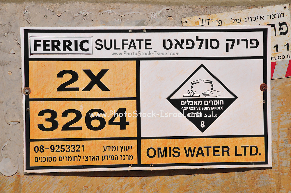 Ferric Sulfate corrosive substance warning sign Photographed in Hadera, Israel.