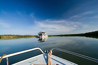Approaching the charter boat MV Pikkuw of Aurukun Wetland Charters on the west coast of remote Cape York in far north Queensland, Australia.