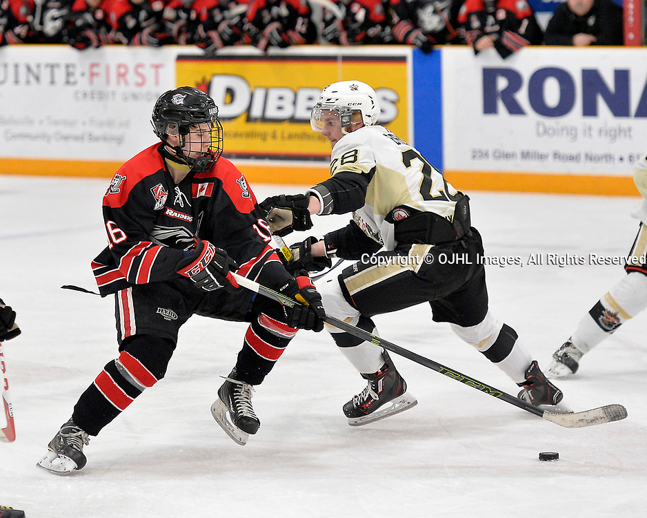 TRENTON, ON  - APR 23,  2017: Ontario Junior Hockey League, Championship Series.  Georgetown Raiders vs the Trenton Golden Hawks in Game 6 of the Buckland Cup Final.  Jack Hughes #16 of the Georgetown Raiders skates with the puck while being defended by Lucas Brown #28 of the Trenton Golden Hawks during the second period.<br /> (Photo by Shawn Muir / OJHL Images)