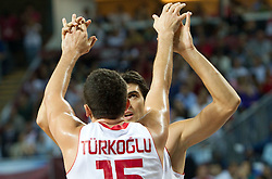 Hidayet Turkoglu of Turkey and Kerem Gonlum of Turkey during  the eight-final basketball match between National teams of Turkey and France at 2010 FIBA World Championships on September 5, 2010 at the Sinan Erdem Dome in Istanbul, Turkey. (Photo By Vid Ponikvar / Sportida.com)