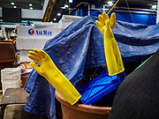 06 JUNE 2018 - SEOUL, SOUTH KOREA: A pair of worker's gloves stick up from a bucket in the Noryangjin Fish Market. The Noryangjin Fish Market is the largest fish market in Seoul and has been in operation since 1927. It opened in the current location in 1971 and was renovated in 2015. The market serves both retail and wholesale customers and has become a tourist attraction in recent years.     PHOTO BY JACK KURTZ