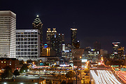 View of the Atlanta skyline and car trails along the downtown I-75/I-85 connector