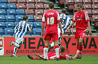 Photo: Paul Thomas.<br /> Huddersfield Town v Swindon Town. Coca Cola League 1. 29/10/2005. <br /> <br /> Chris Brandon celebrates Hudderfield's goal as Swindon players look dejected.