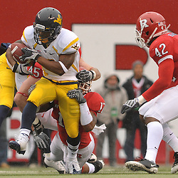 Dec 5, 2009; Piscataway, NJ, USA; West Virginia wide receiver Jock Sanders (9) runs through a tackle attempt by Rutgers linebacker Damaso Munoz (17) during first half NCAA Big East college football action between Rutgers and West Virginia at Rutgers Stadium.