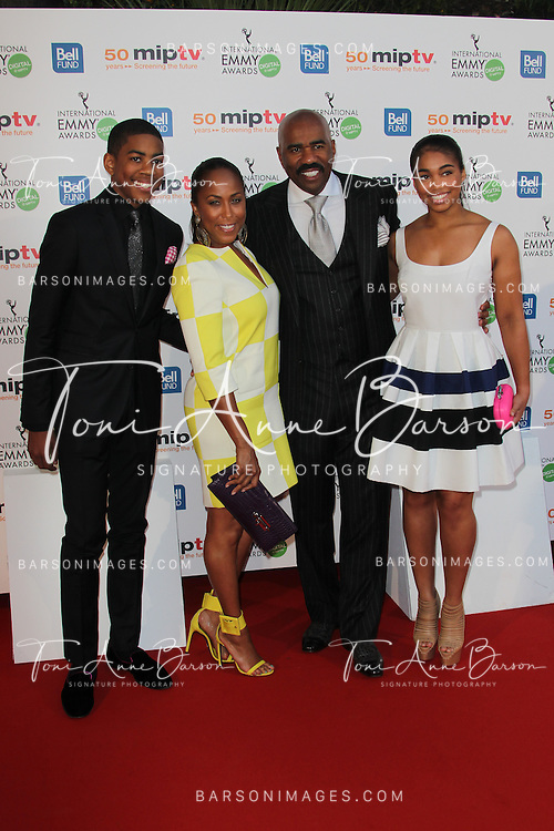 CANNES, FRANCE - APRIL 08:  Steve Harvey and Family arrives at the MIPTV 50th Anniversary : Opening Party at the Martinez Hotel on April 8, 2013 in Cannes, France.  (Photo by Tony Barson/Getty Images)