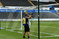 Football - 2019 / 2020 Championship - Swansea City vs Sheffield Wednesday<br /> <br /> ground staff spray the posts with disinfectant at half time <br /> in a match played with no crowd due to Covid 19 coronavirus emergency regulations, at the almost empty Liberty Stadium.<br /> <br /> COLORSPORT/WINSTON BYNORTH