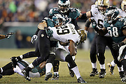 New Orleans Saints running back Khiry Robinson (29) gets tackled as he runs the ball late in the fourth quarter during the NFL NFC Wild Card football game against the Philadelphia Eagles on Saturday, Jan. 4, 2014 in Philadelphia. The Saints won the game 26-24. ©Paul Anthony Spinelli