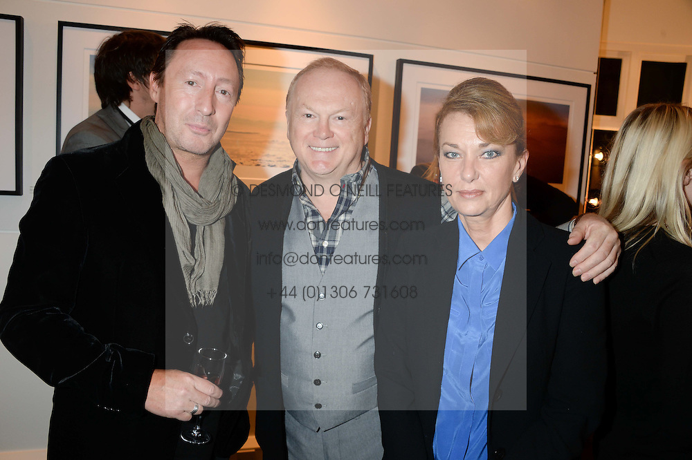 Left to right, JULIAN LENNON, Song writer MIKE BATT and his wife JULIANNE at a private view of Photographs by Julian Lennon held at The Little Black Gallery, 13A Park Walk, London SW10 on 17th September 2013.