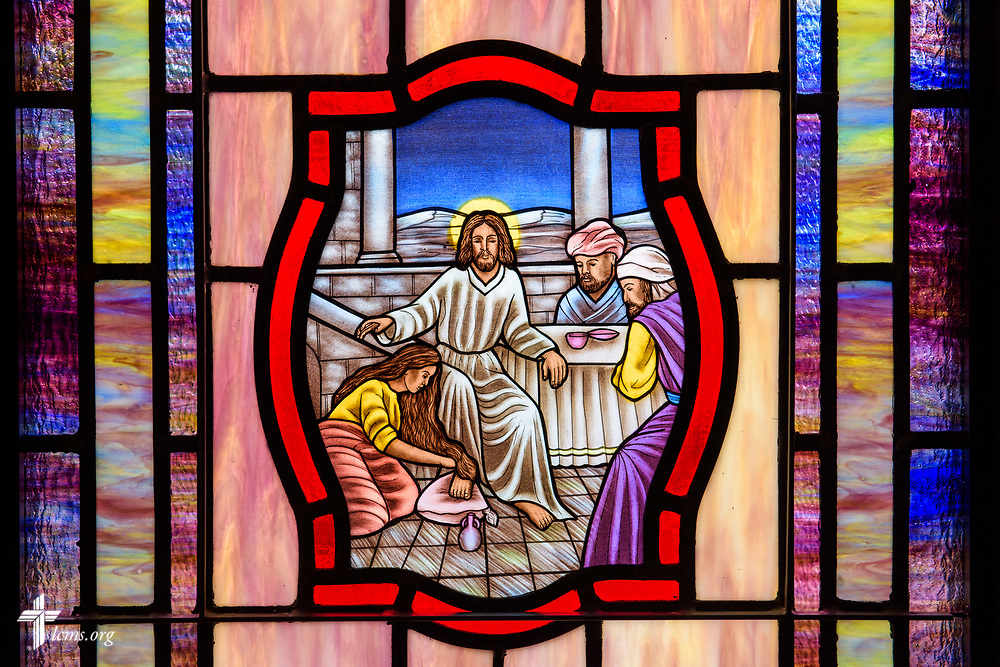 Stained glass depicting the woman washing the feet of Jesus (John 12), at St. John's Lutheran Church, Conover, N.C, on Friday, April 21, 2017. LCMS Communications/Erik M. Lunsford
