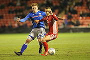 Callum Camps challenges during the EFL Sky Bet League 1 match between Walsall and Rochdale at the Banks's Stadium, Walsall, England on 6 March 2018. Picture by Daniel Youngs.
