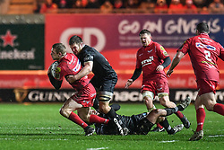 Scarlets' Johnny McNicholl is tackled by Ospreys' Olly Cracknell - Mandatory by-line: Craig Thomas/Replay images - 26/12/2017 - RUGBY - Parc y Scarlets - Llanelli, Wales - Scarlets v Ospreys - Guinness Pro 14