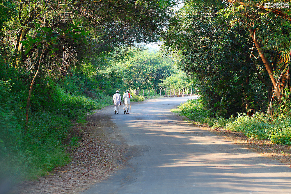 TWO MEN, WALKING ON THE ROAD