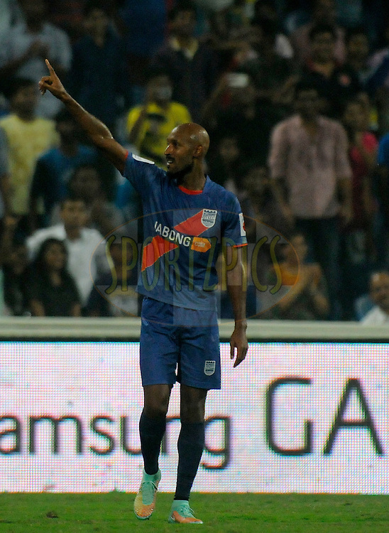 Nicolas Anelka of Mumbai City FC celebrates after hitting a goal during match 22 of the Hero Indian Super League between Mumbai City FC and Delhi Dynamos FC City held at the D.Y. Patil Stadium, Navi Mumbai, India on the 5th November.<br /> <br /> Photo by:  Pal Pillai/ ISL/ SPORTZPICS