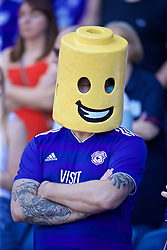 CARDIFF, WALES - Saturday, April 20, 2019: A Cardiff City supporter with a lego head during the FA Premier League match between Cardiff City FC and Liverpool FC at the Cardiff City Stadium. (Pic by David Rawcliffe/Propaganda)