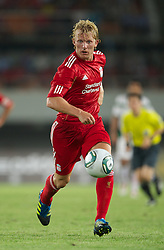 GUANGZHOU, CHINA - Wednesday, July 13, 2011: Liverpool's Dirk Kuyt in action against Guangdong Sunray Cave during the first pre-season friendly on day three of the club's Asia Tour at the Tianhe Stadium. (Photo by David Rawcliffe/Propaganda)